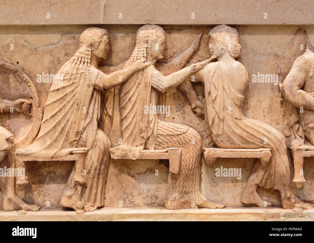 Delphi, Phocis, Greece.  Delphi Archaeological museum.  Section from the eastern frieze of the Treasury of the Siphnians. Stock Photo