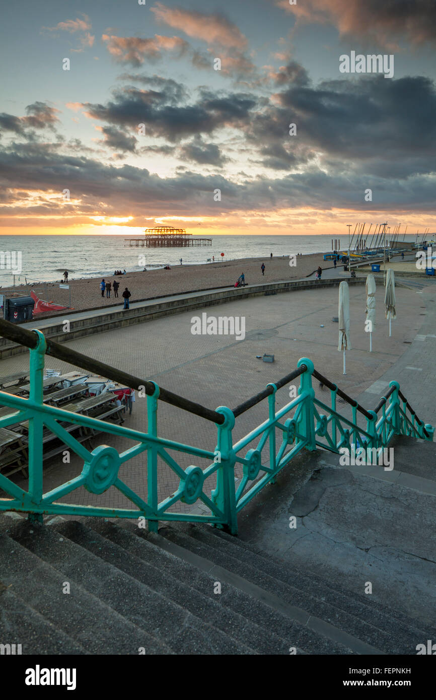Winter sunset on Brighton seafront, East Sussex, England. West Pier ruins in the distance. - Stock Image
