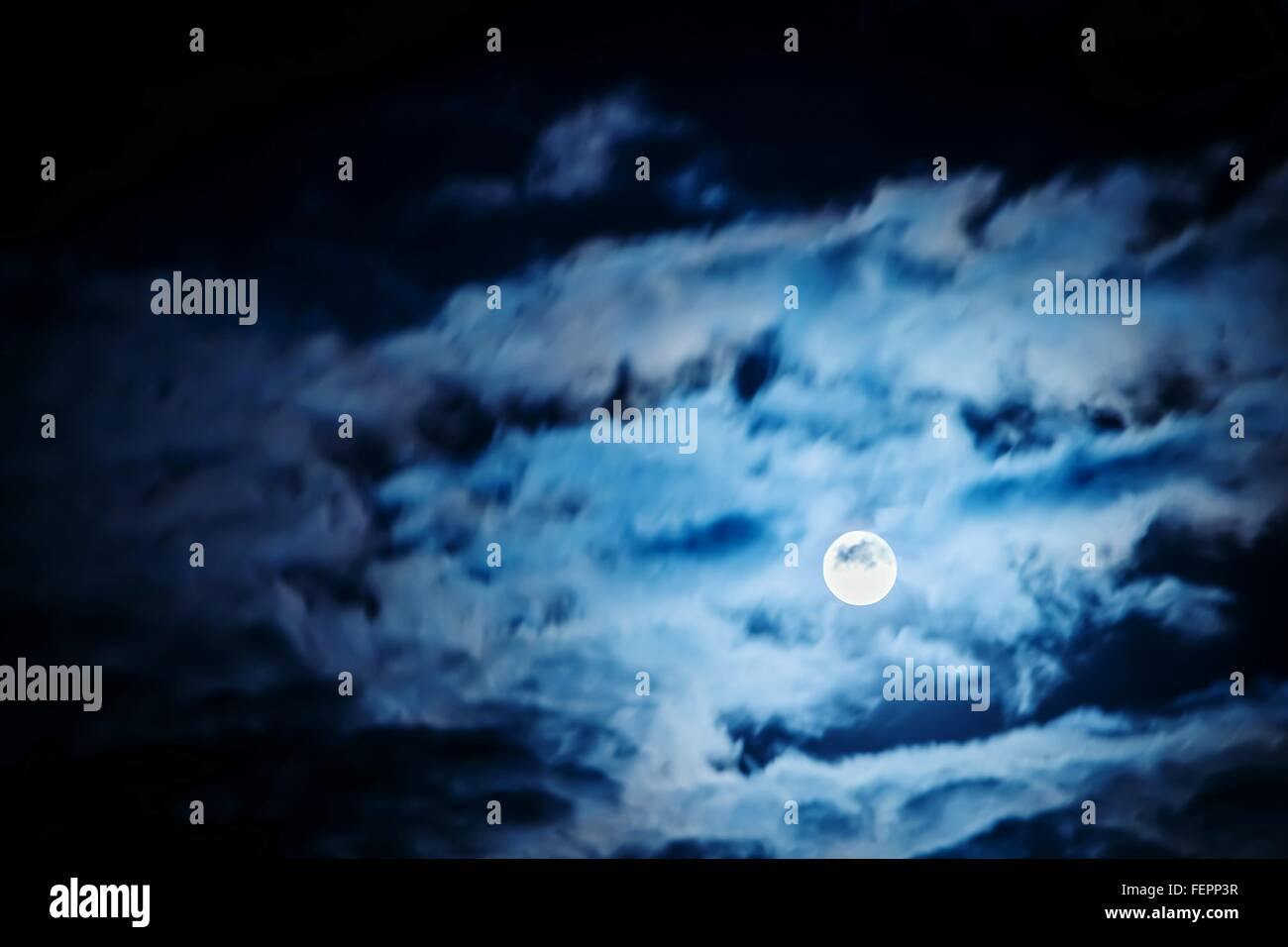 Low Angle View Of Moon In Cloudy Sky - Stock Image
