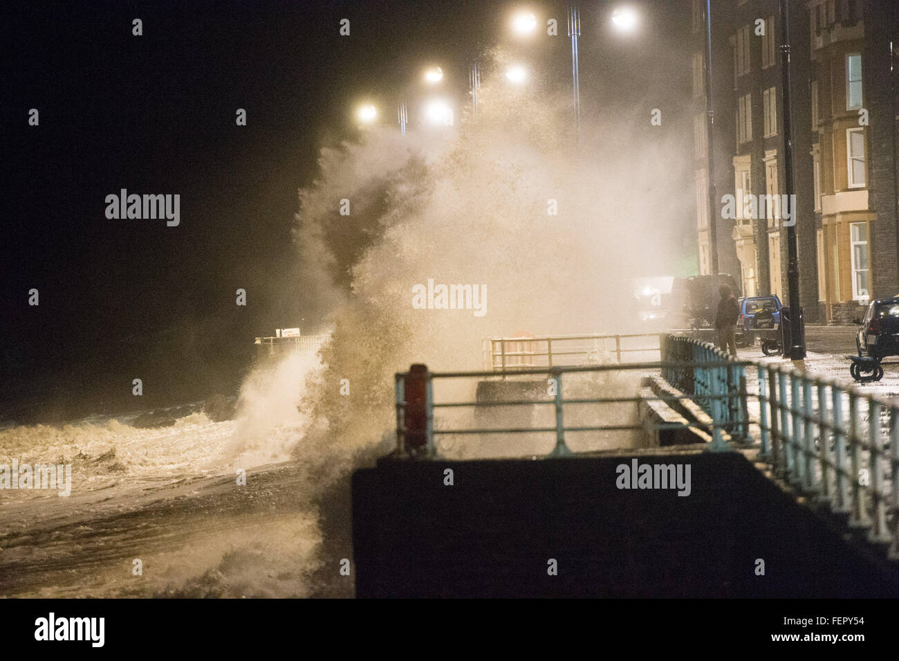 Aberystwyth Ceredigion , west Wales UK, Monday  08 February 2016  As the evening  high tide reaches its peak, the - Stock Image