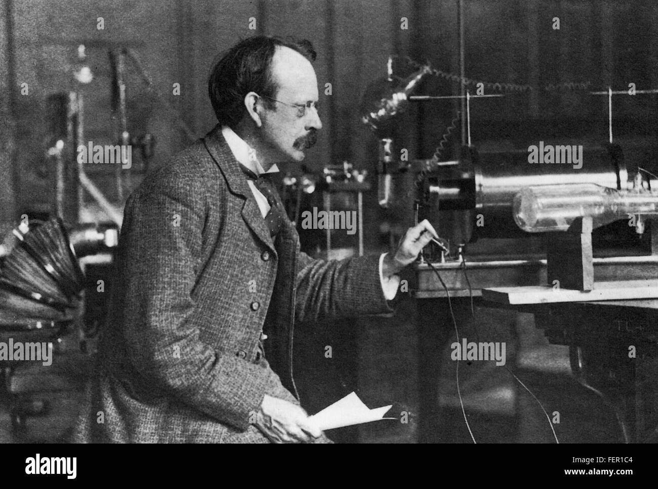 JOSEPH JOHN THOMSON (1856-1940) English physicist  with the cathode ray tube he used in his discovery of the electron Stock Photo