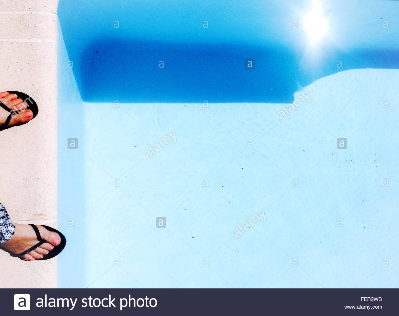 Low Section Of Woman By Swimming Pool - Stock Image