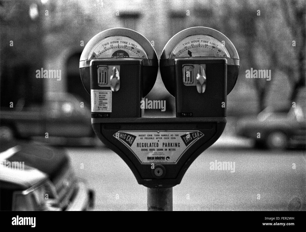 Close-Up Of Parking Meter Against Street - Stock Image