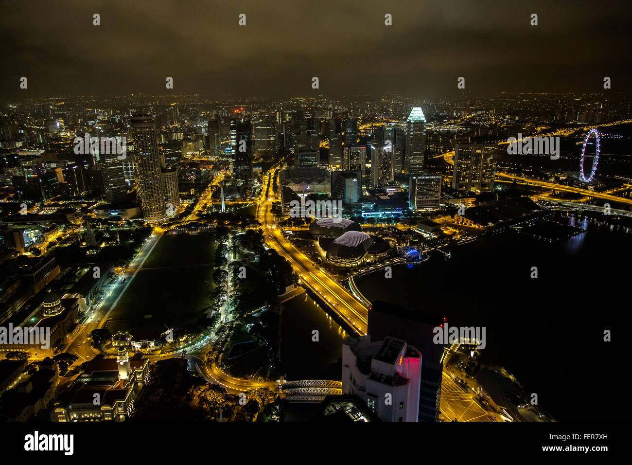Aerial View Of Illuminated Cityscape Against Sky At Night - Stock Image