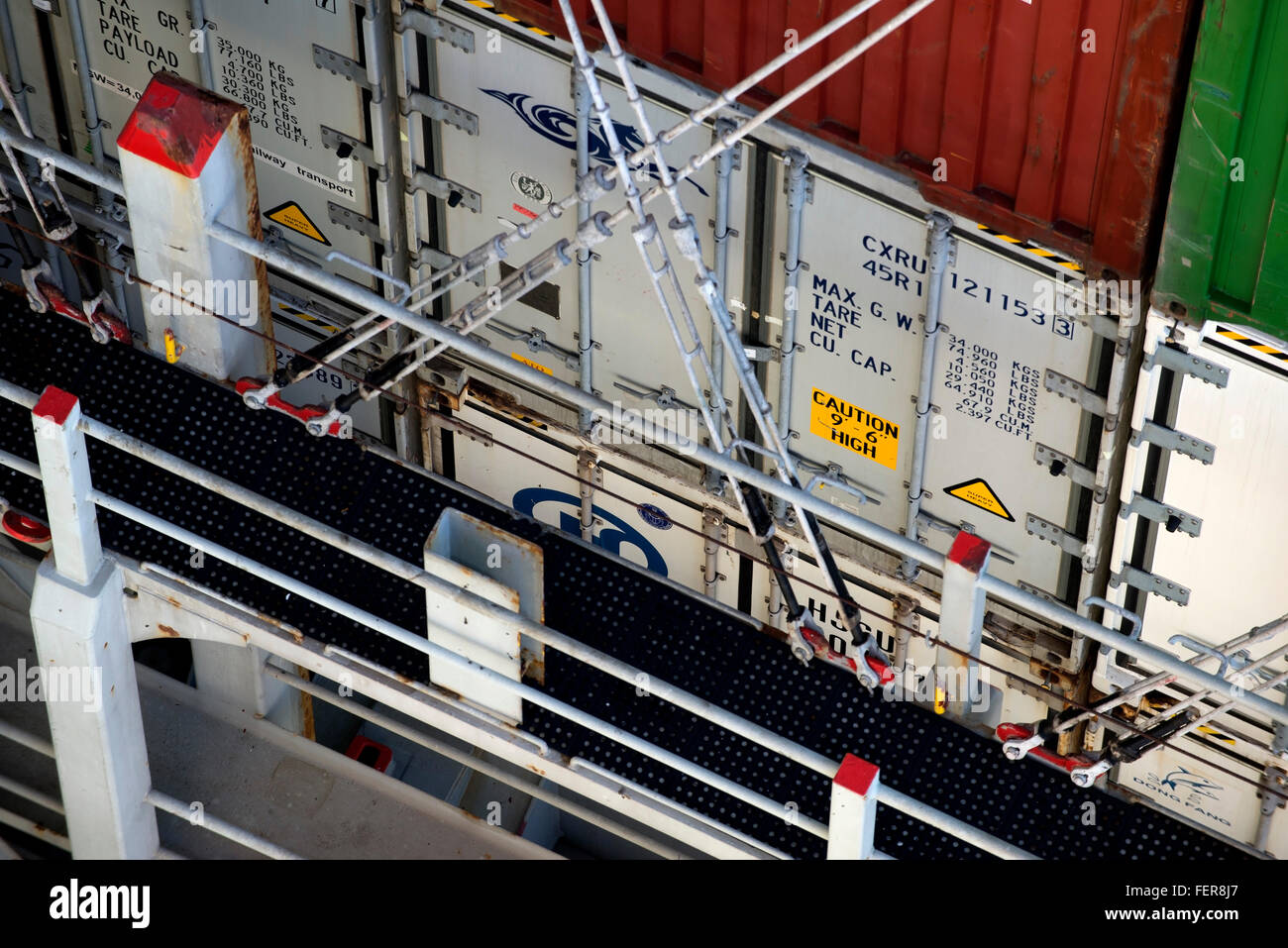 Container shipments. Rods lashed to the vessel secure containers on board the ship - Stock Image