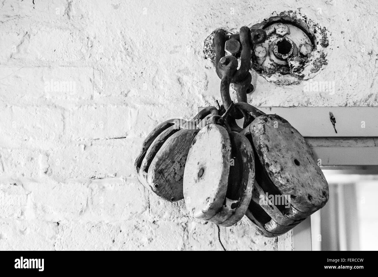 Close-Up Of Pulley Wheels On Wall Stock Photo: 95171689 - Alamy