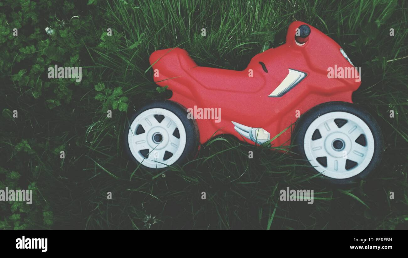 High Angle View Of Bike Toy On Grass In Yard - Stock Image