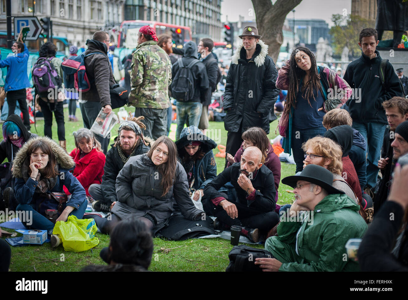 Attentive activists listening to a talk at Occupy Parliament Square, London - Stock Image