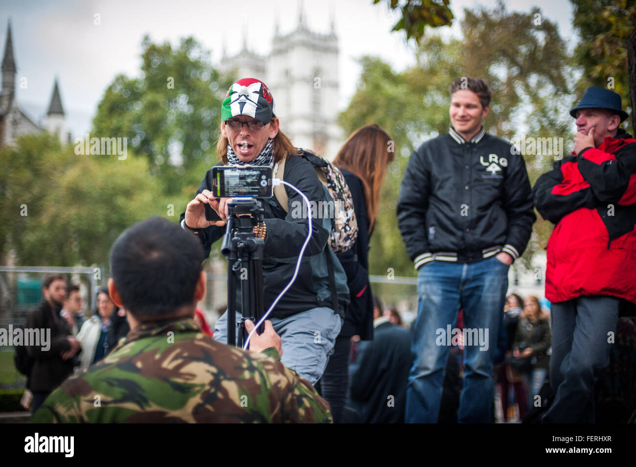 Activists enjoying themselves at Occupy Parliament Square, London - Stock Image