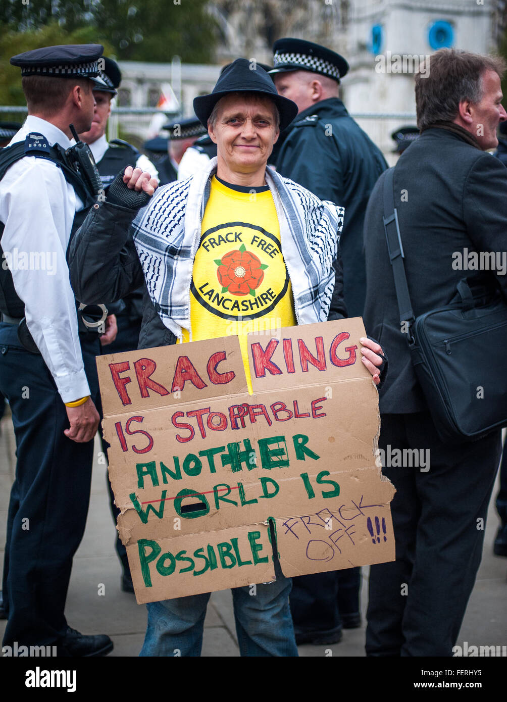 Occupy Parliament Square, anti-fracking protester and placard, London - Stock Image