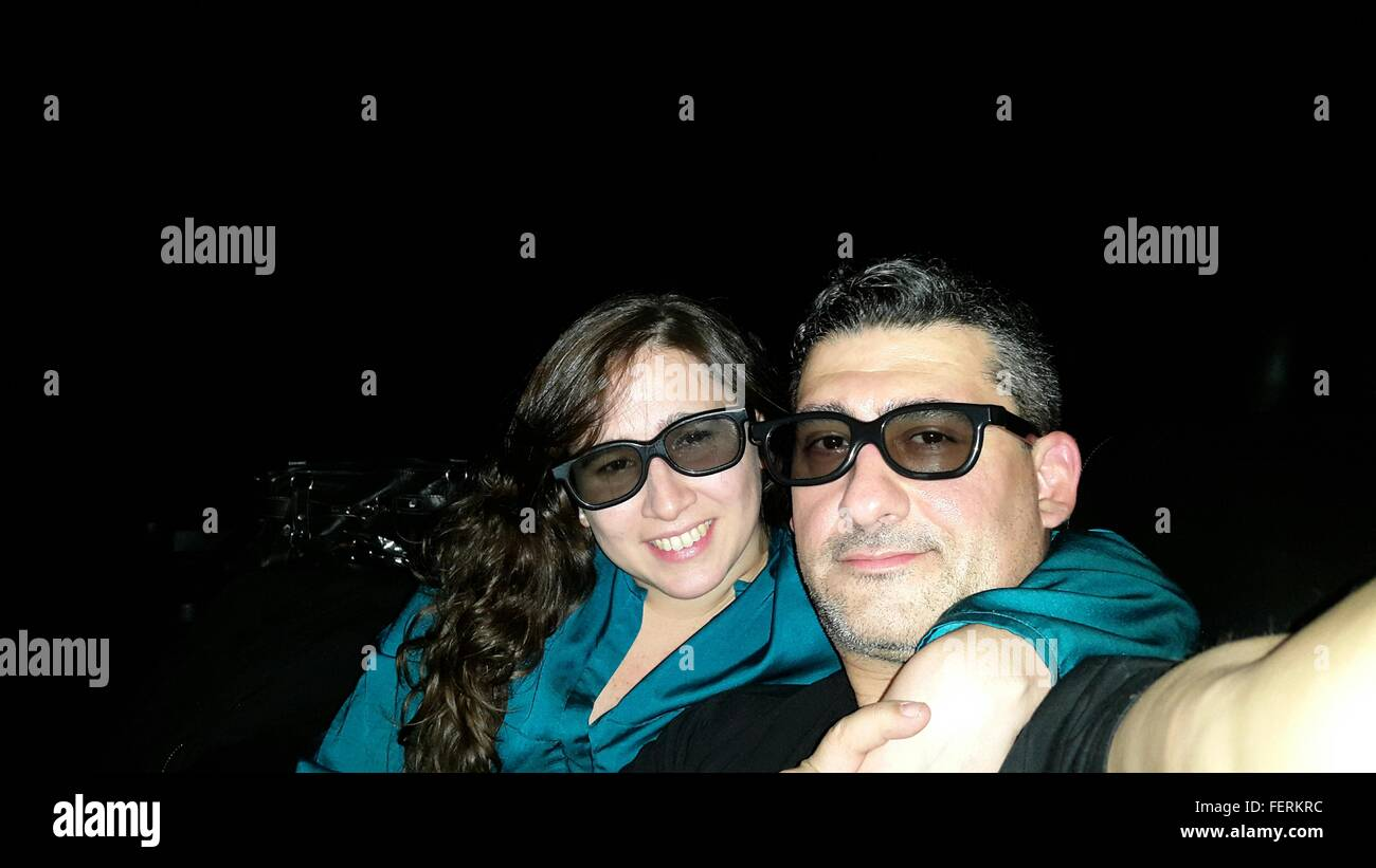 Portrait Of Couple In 3-D Glasses At Movie Theatre - Stock Image