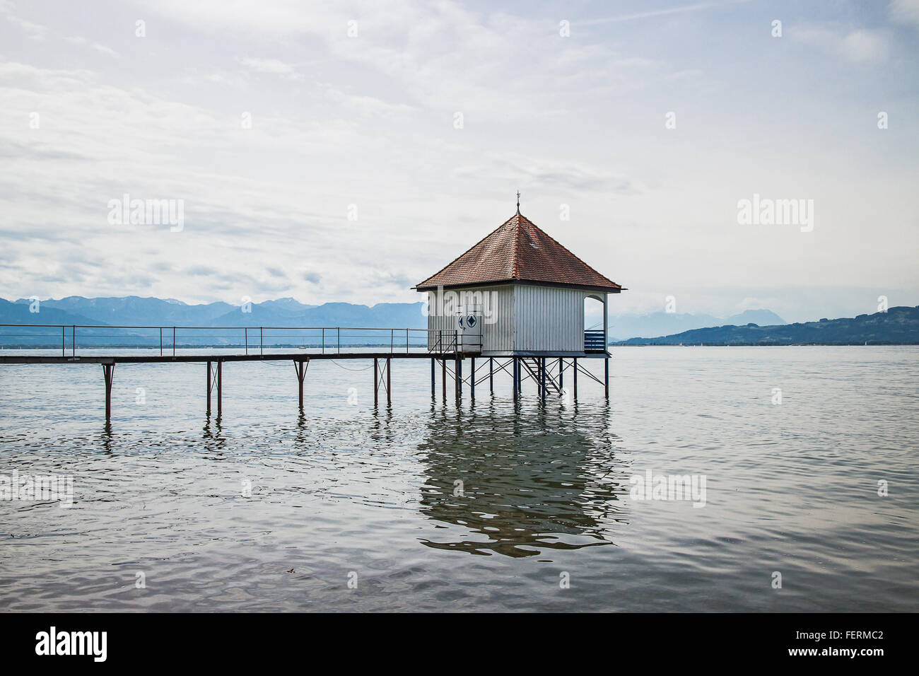 View over Lake Constance with the Swiss and Austrian Alps in the background near the City of Lindau, Bavaria, Germany - Stock Image