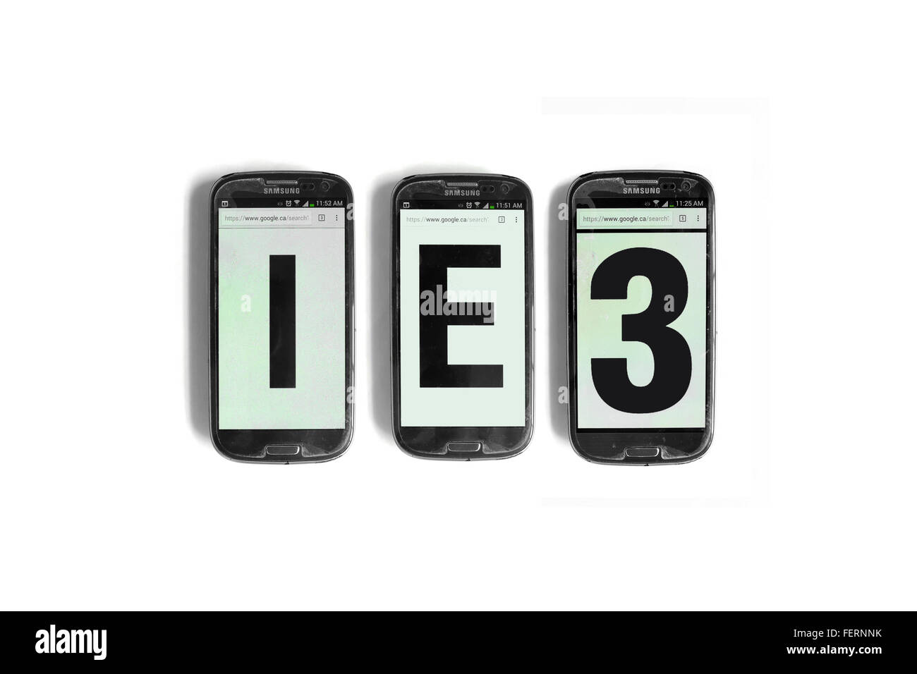 IE3 on the screens of smartphones photographed against a  white background. - Stock Image