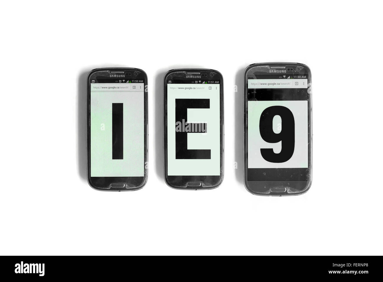 IE9 on the screens of smartphones photographed against a  white background. - Stock Image