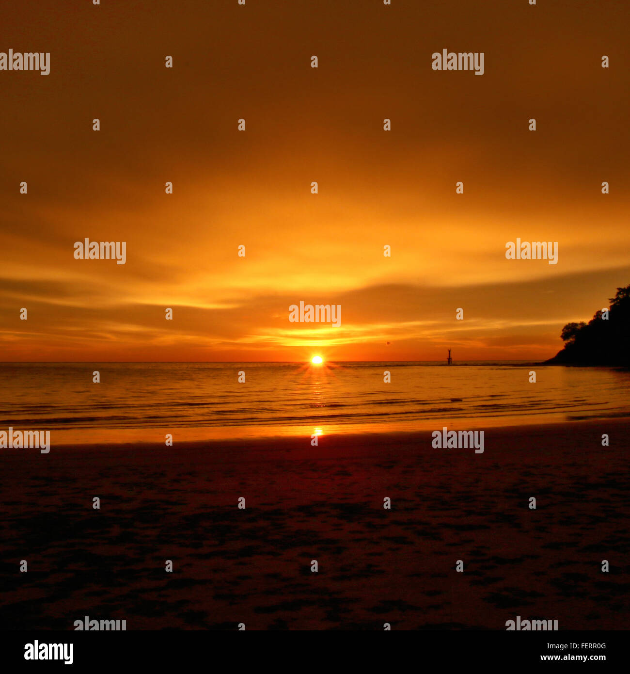 Scenic View Of Sunset Over Sea - Stock Image