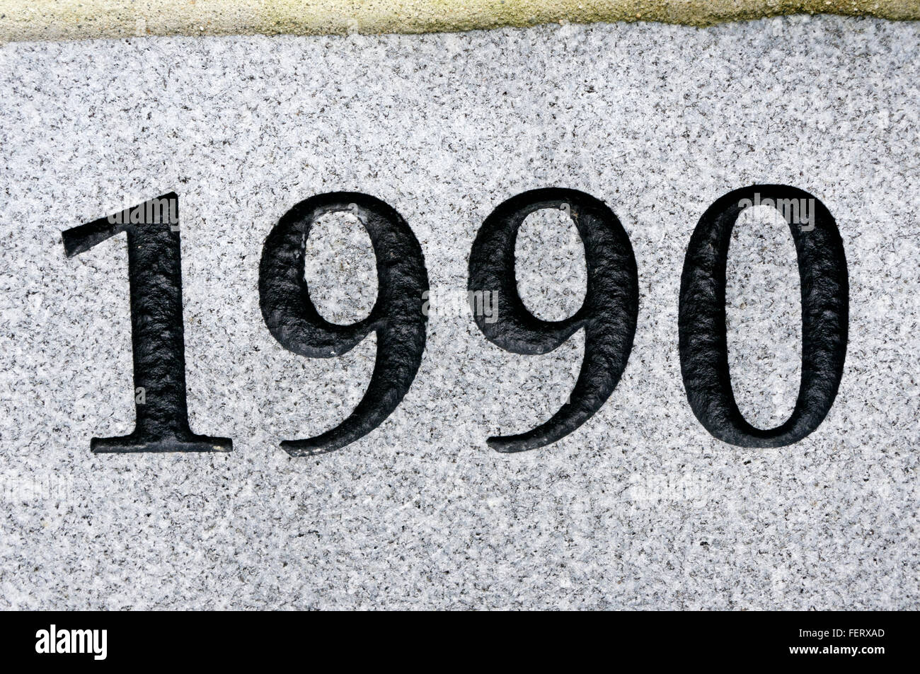 1990 house number carved in granite - Stock Image
