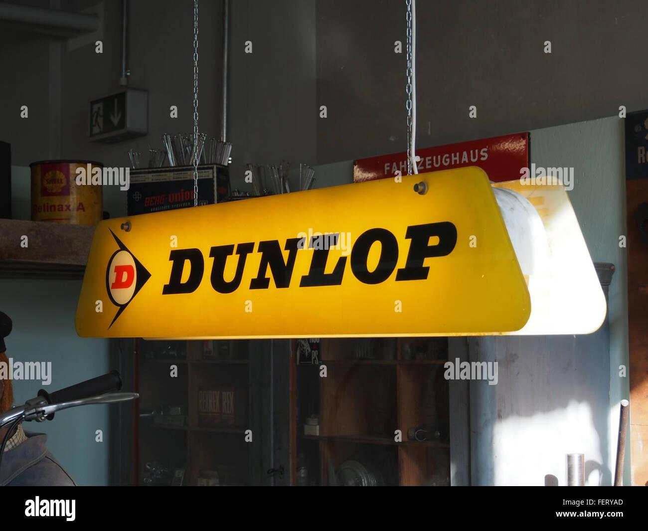 Dunlop, luminous advertising sign, Auto & Uhrenwelt Schramberg - Stock Image