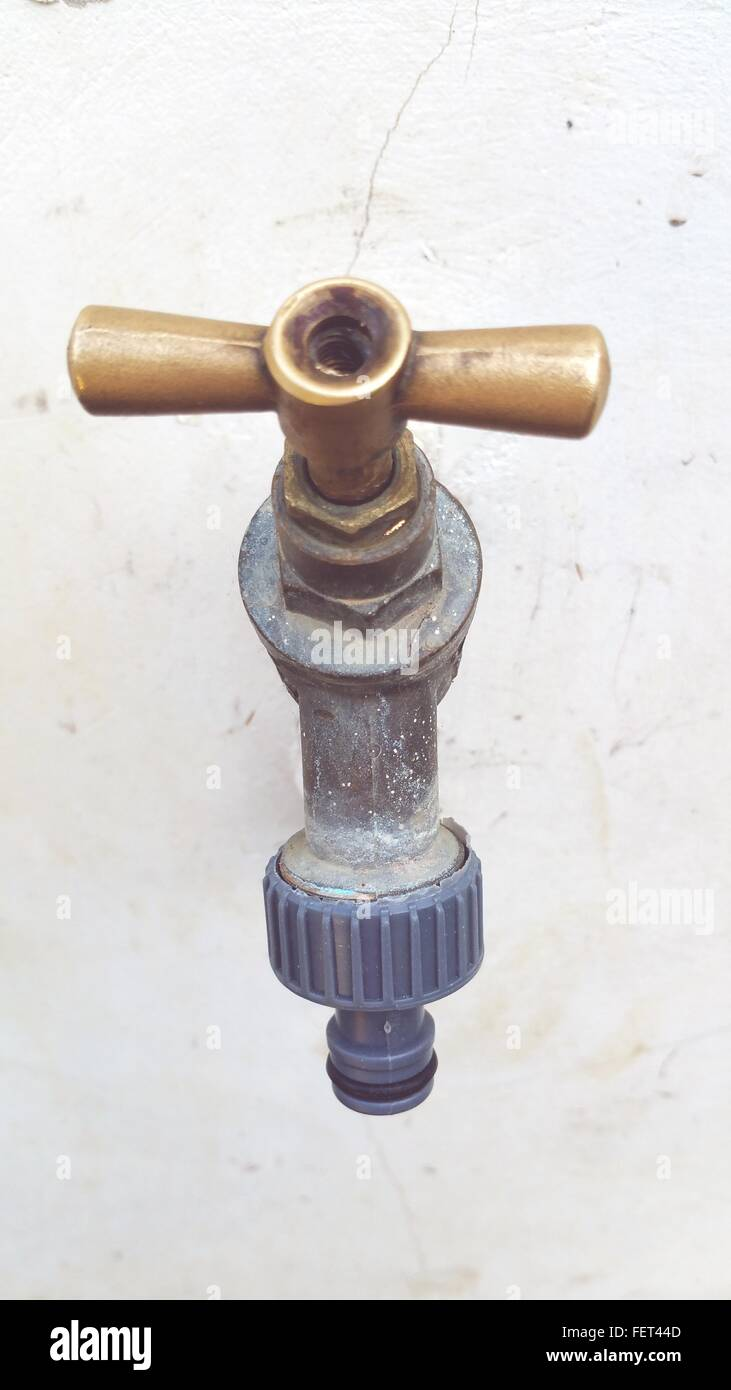 Close-Up Of Tap Against Wall - Stock Image