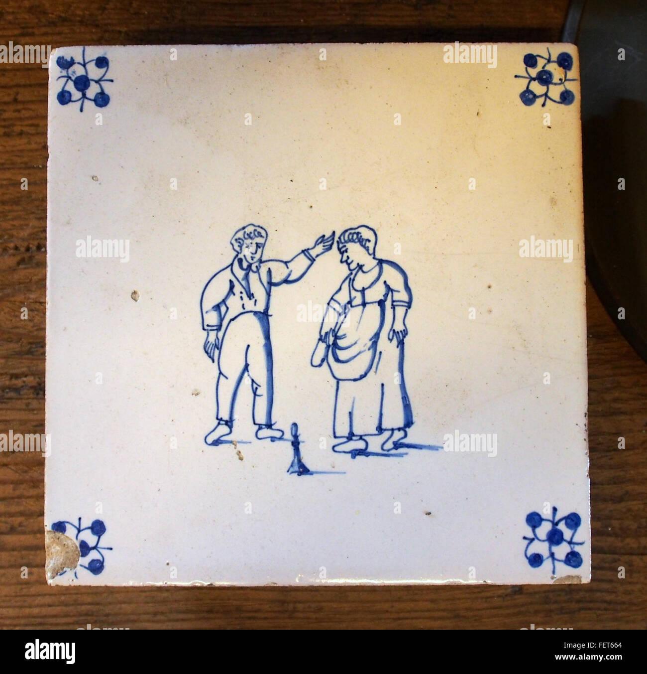 Delftware tiles depicting 2 persones - Stock Image