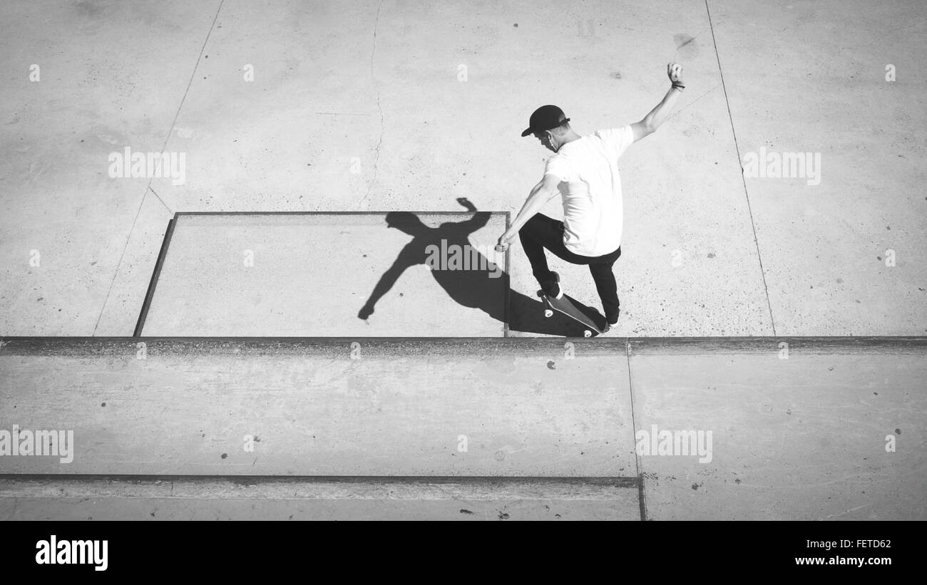 High Angle View Of Young Man Skateboarding - Stock Image
