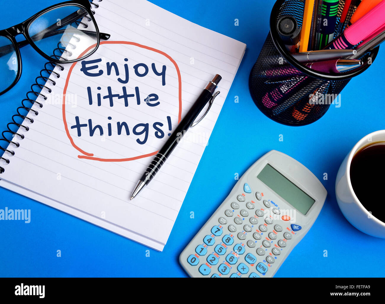 Enjoy little things word on notepad Stock Photo