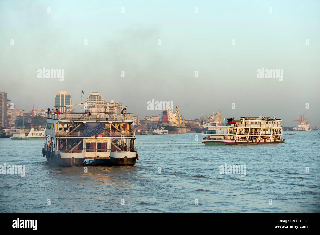 Passenger boats on the Irrawaddy river, Burma Stock Photo