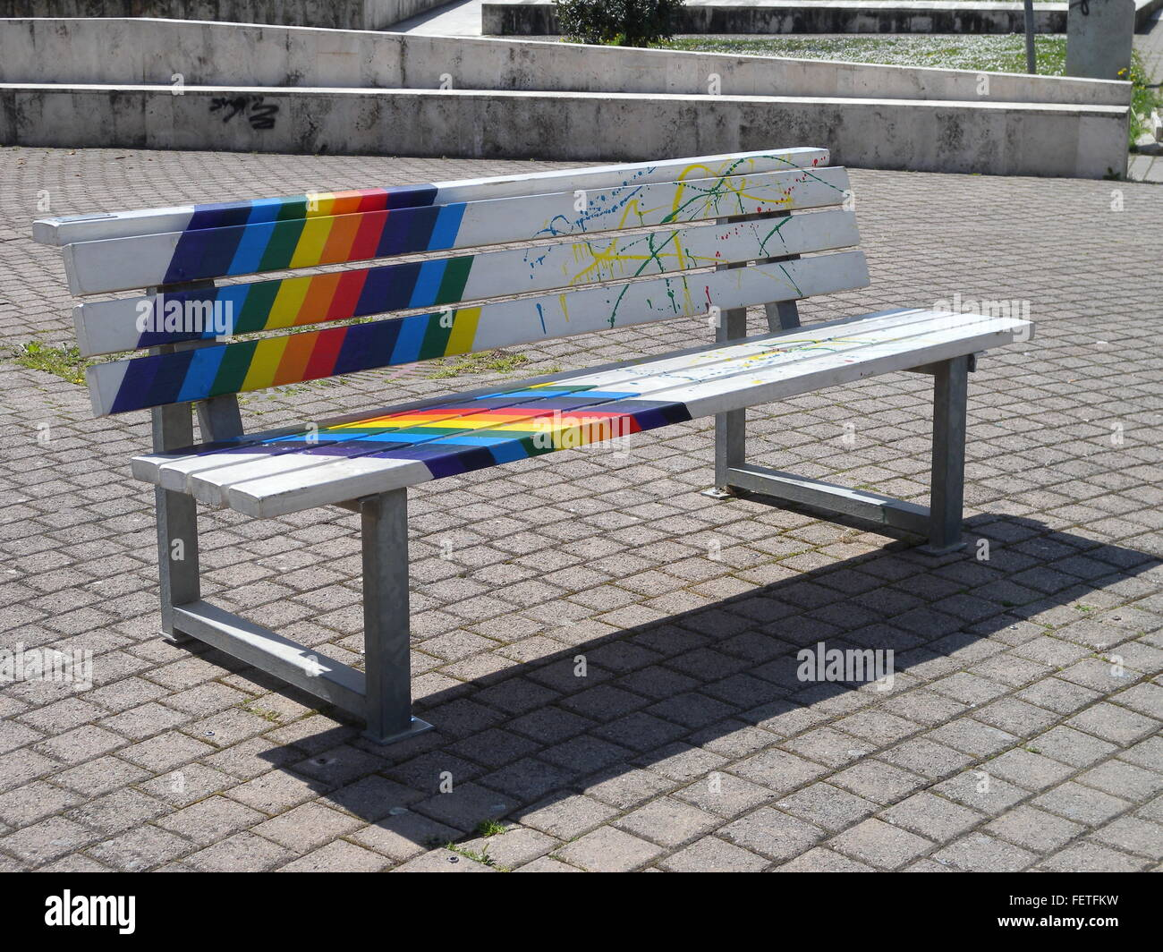 Bench On Square With Rainbow Colors - Stock Image