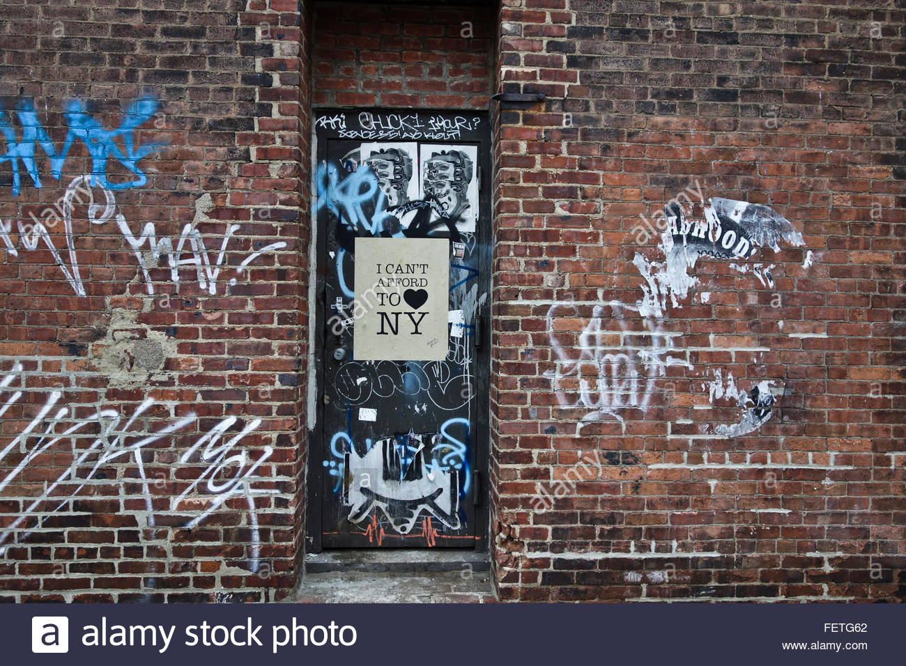 Graffiti on door and brick walls