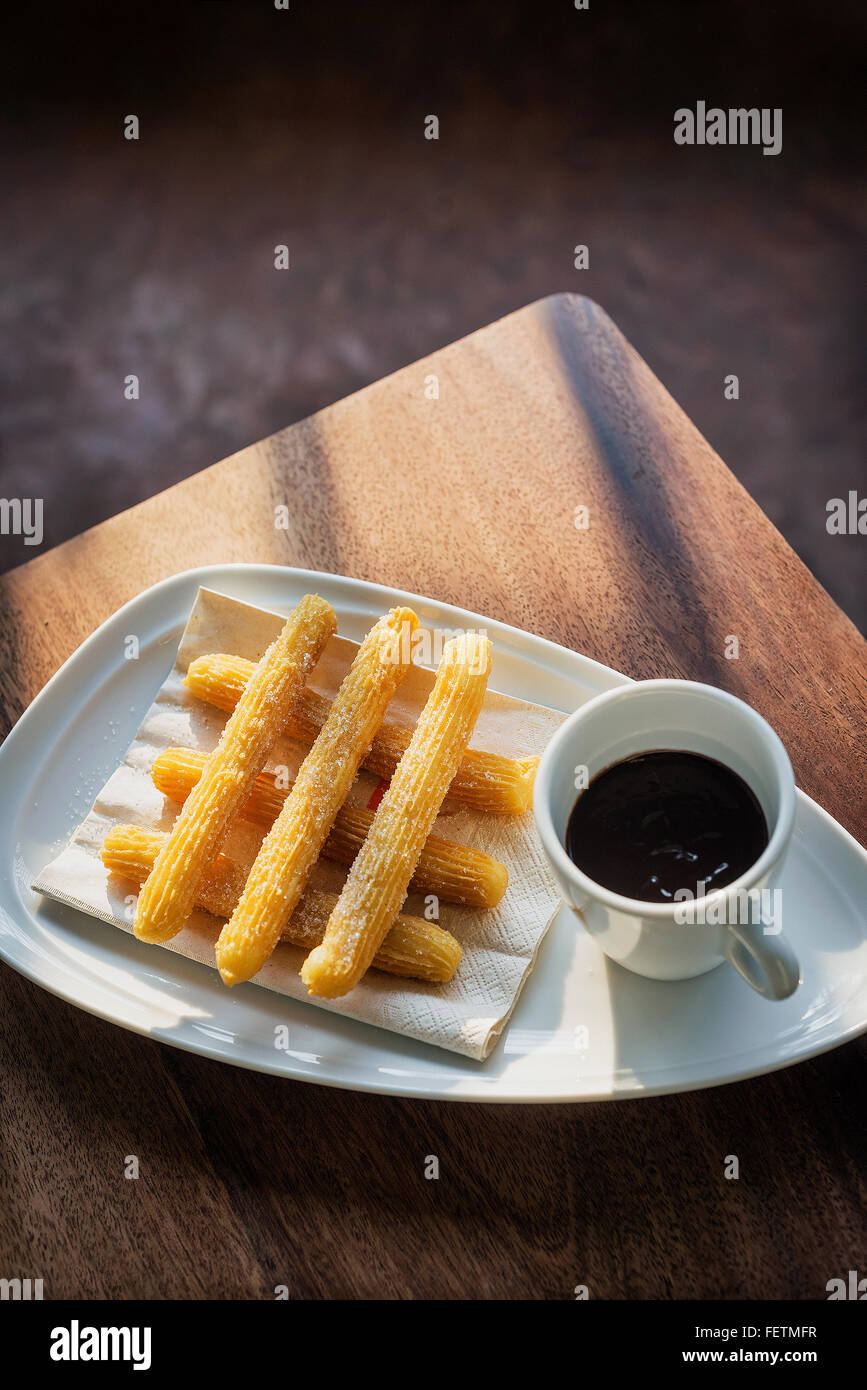 chocolate and churros traditional spanish breakfast tapa snack food - Stock Image