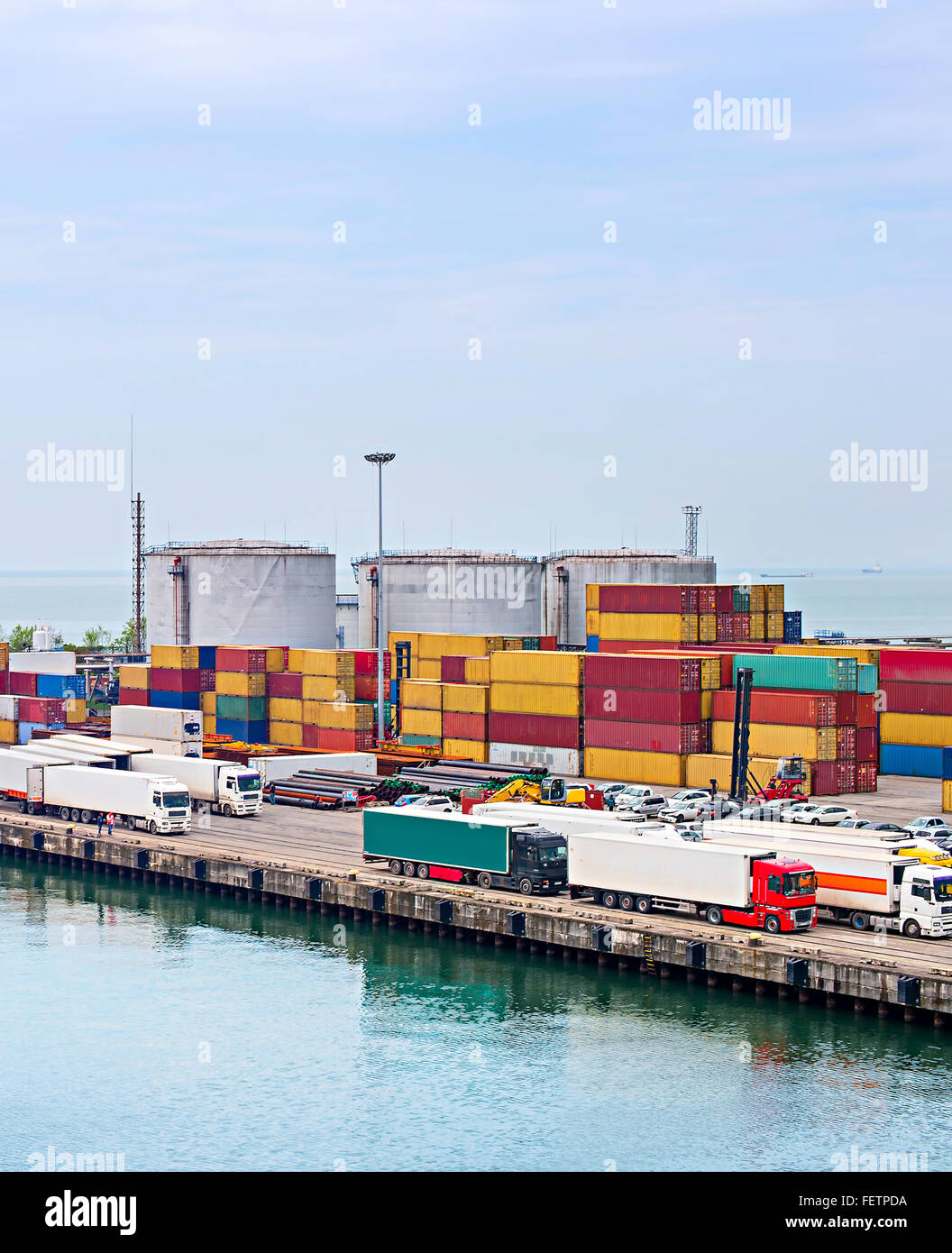 Trucks and containers in Batumi industrial sea port. Georgia - Stock Image