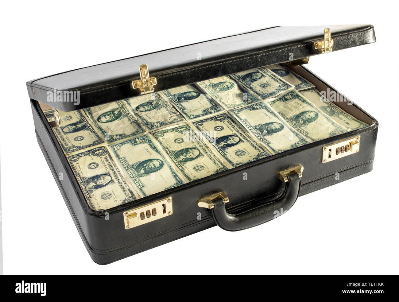 Black leather briefcase packed with money with the lid raised to show stacks of dollar bills - Stock Image