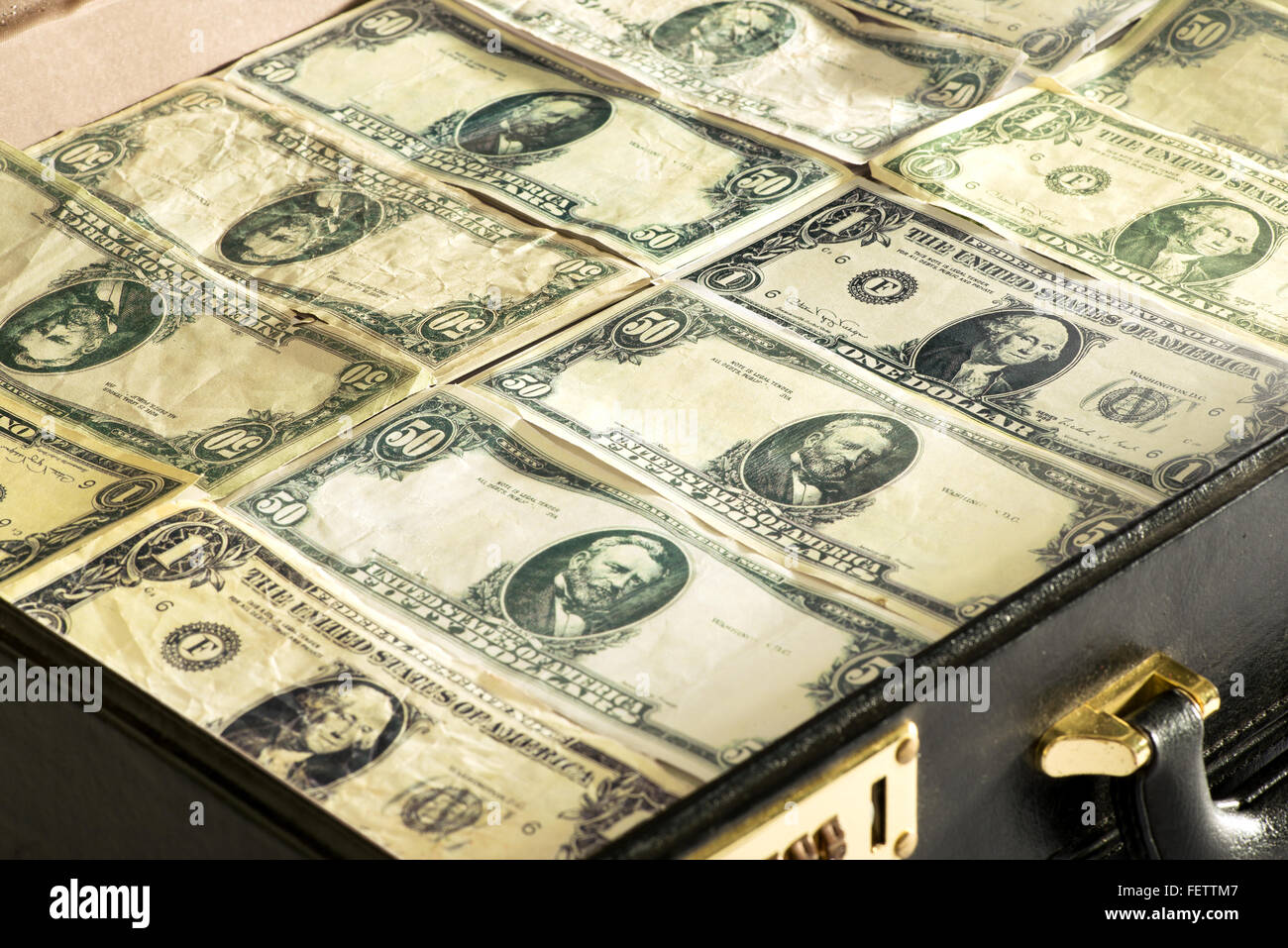 Close up of dollar banknotes or greenbacks closely packed into a briefcase - Stock Image