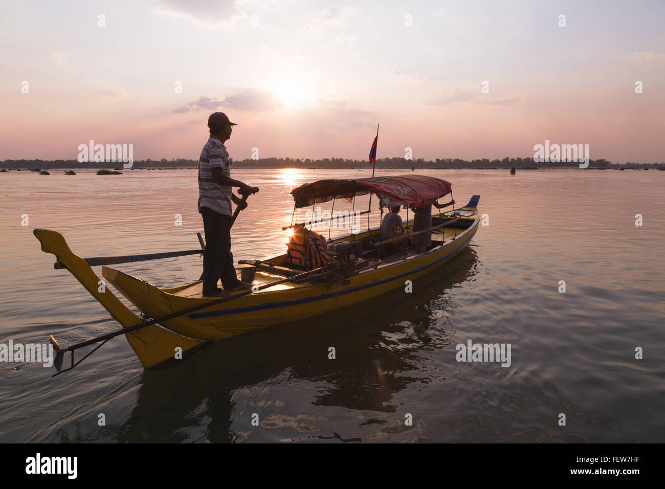 Fresh water dolphin watching on the Mekong, Cambodia. Stock Photo