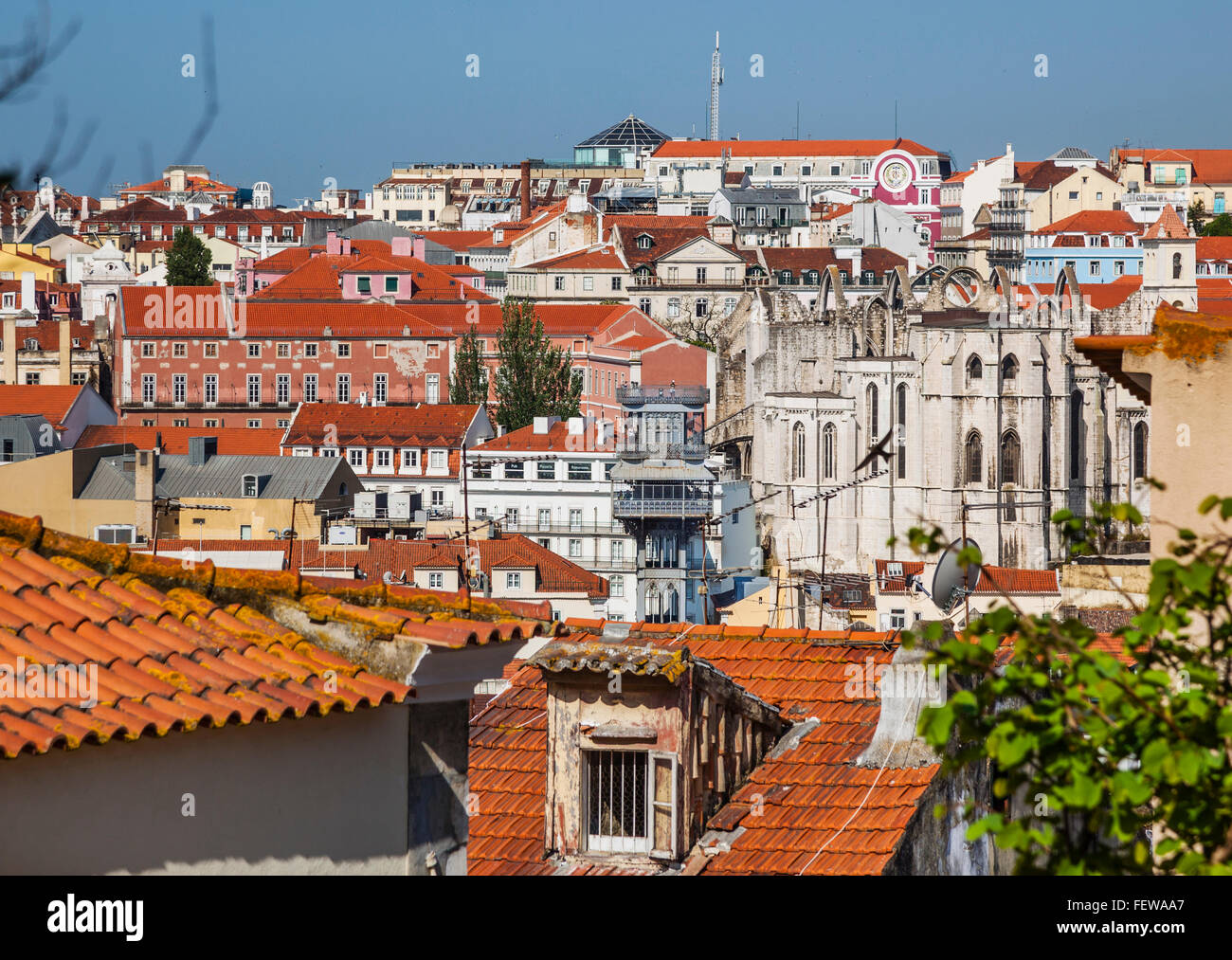 Portugal, Lisbon, view  over the roofs of the Baixa neighborhood towards the Santa Justa Lift and the ruins of the - Stock Image