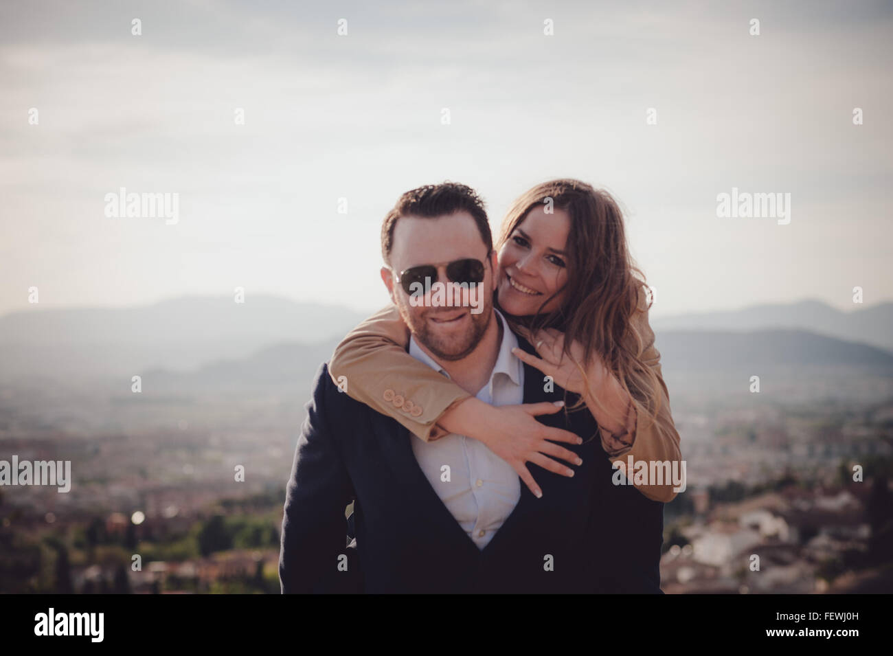 Couple Doing Piggyback Ride - Stock Image