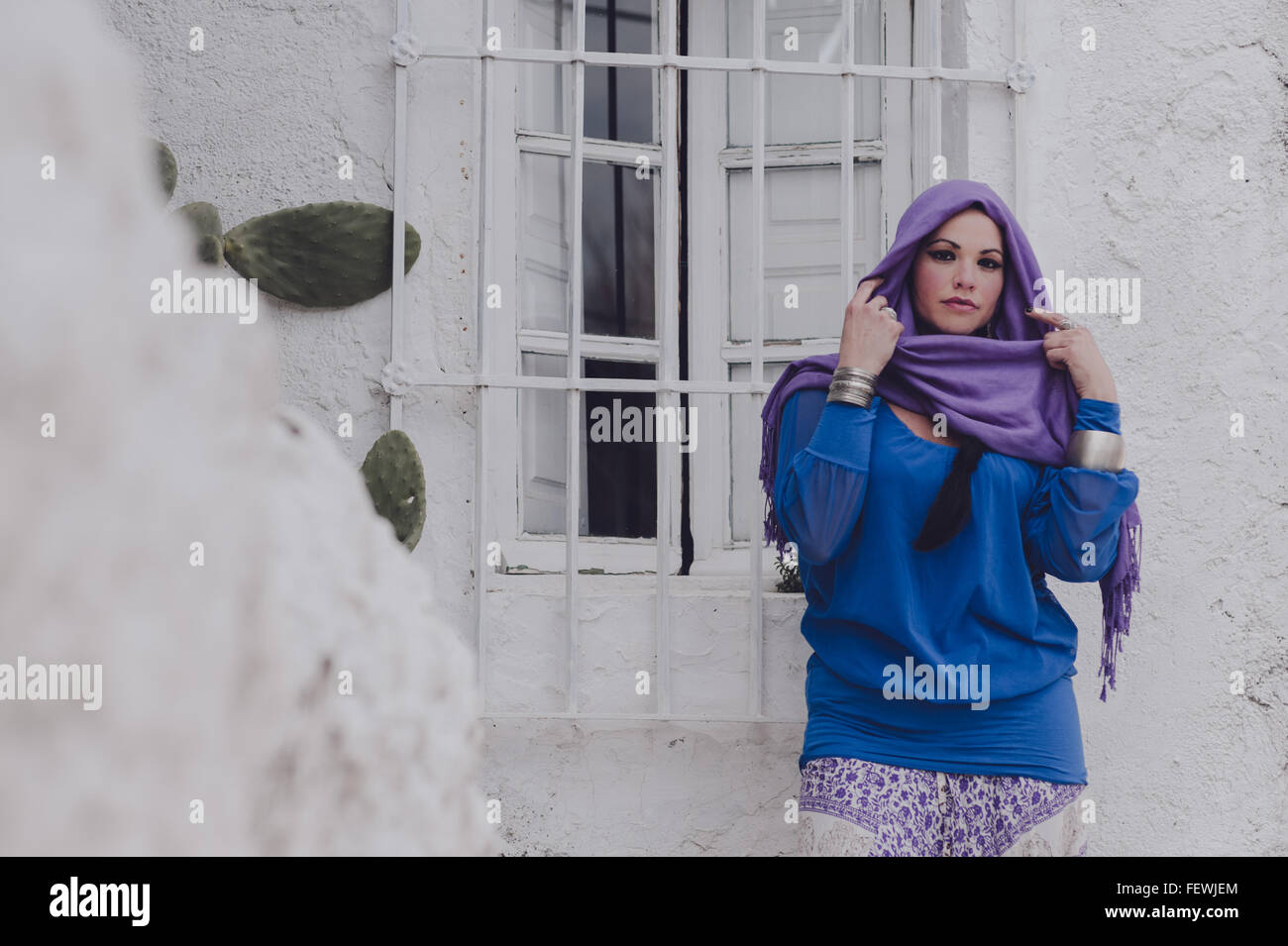 Woman Wearing Headscarf - Stock Image