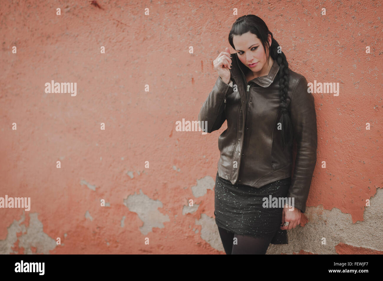 Woman Leaning On Wall - Stock Image