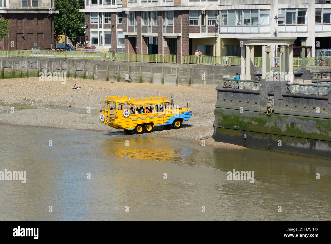 Duck Tours amphibious tourist bus leaving the River Thames on the South Bank in London, England - Stock Image