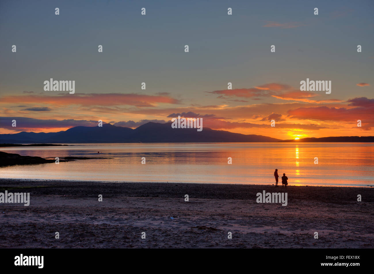 Sunset over Ganavan sands and a distant Mull, Oban, Argyll - Stock Image