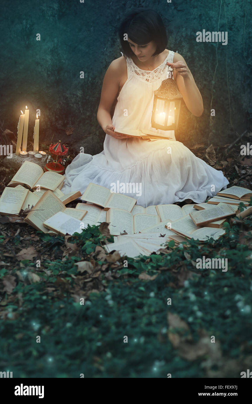 Beautiful Woman Reading Books In The Dark Forest. Surreal ...