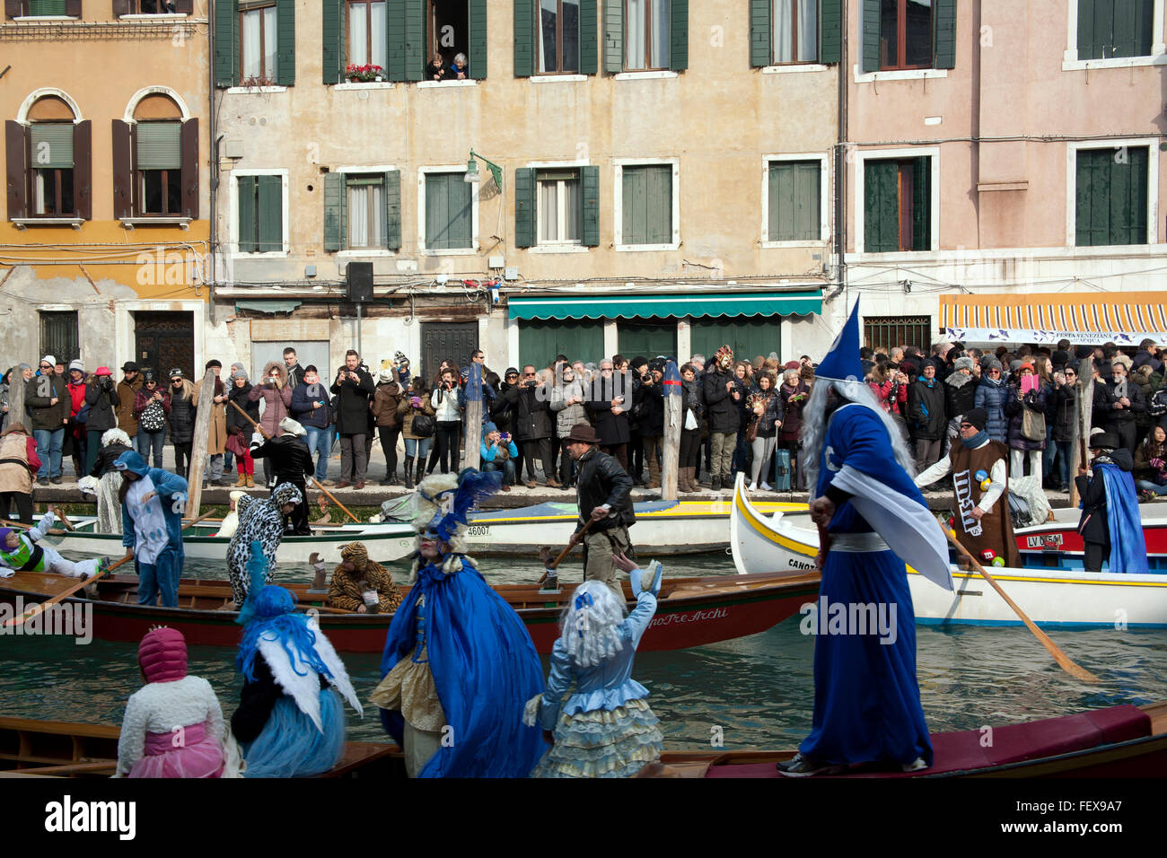 Boats of the water parade Rowing Associations on the canal at the start of the 2016 Venice carnival, Cannaregio Stock Photo