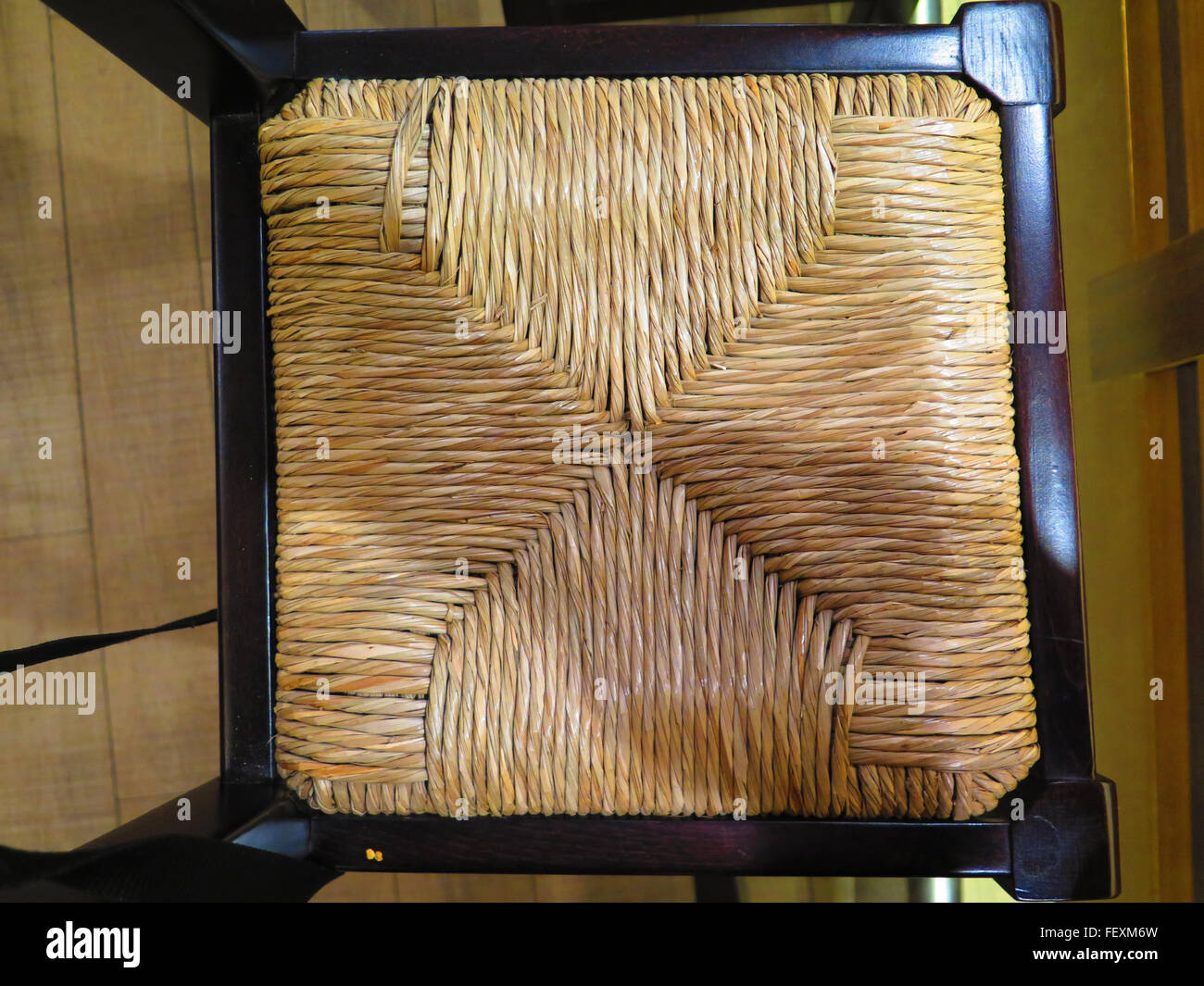 Close-up of rush woven wooden chair seat - Stock Image