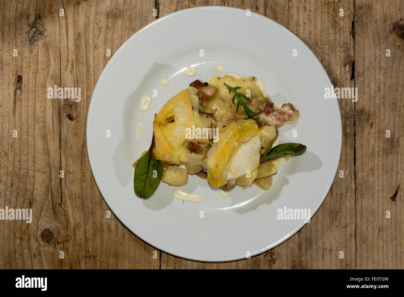 Savoie tartiflette. French dish made with potatoes, reblochon cheese, lardons and onions - Stock Image