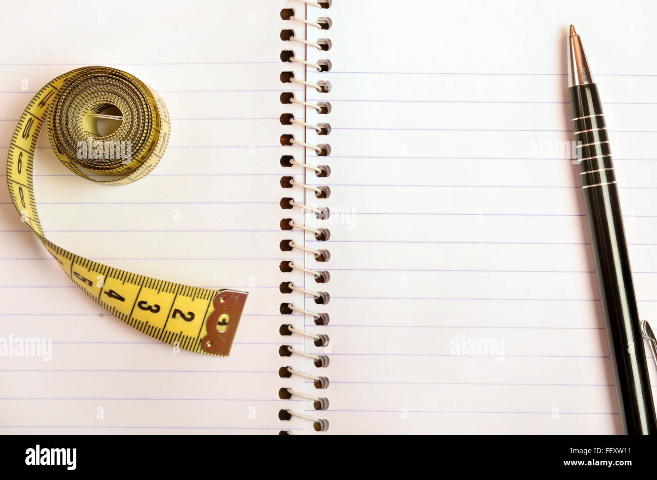 Notepad with centimeter and pen - Stock Image