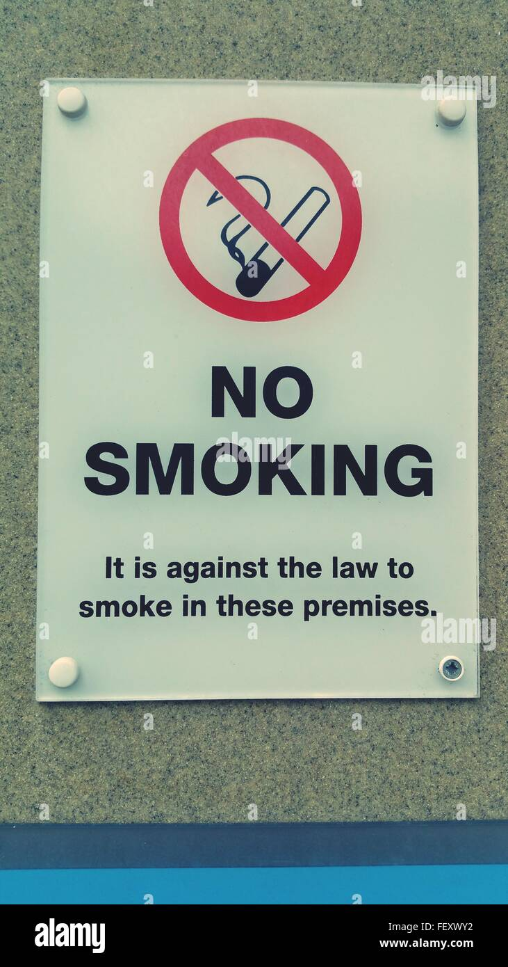 Close-Up Of No Smoking Sign On Wall Stock Photo