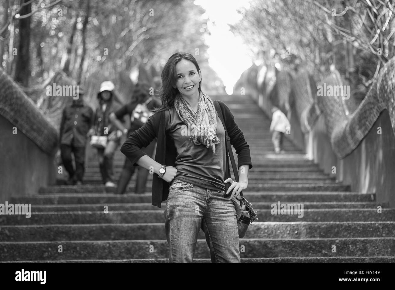 Portrait Of Mid Adult Woman In Casuals With Standing On Steps - Stock Image