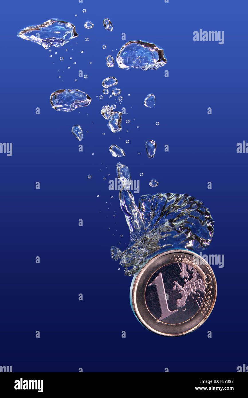One euro coin falling into water. - Stock Image