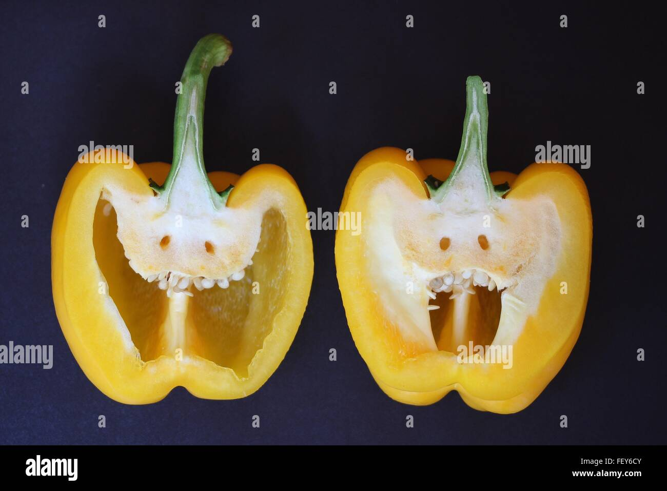 Close-Up Of Halved Yellow Pepper With Anthropomorphic Face Stock Photo