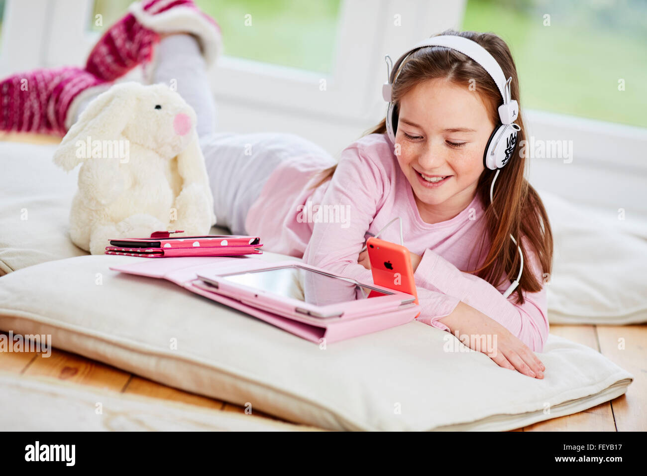 Young girl listen to her music - Stock Image