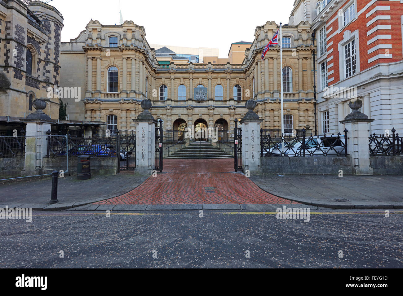 The old Crown court building in the Forbury gardens area with its gated entrance and old bath stone building. - Stock Image
